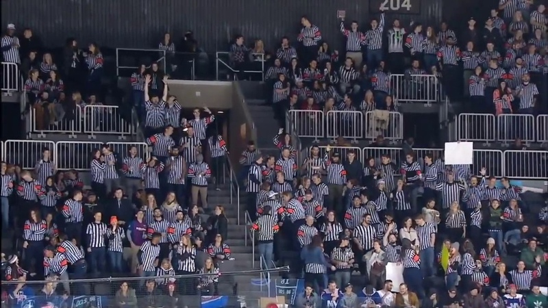 Fans come out dressed as referees for the Islanders Canucks game